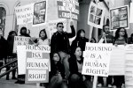 Esperanza Promotoras and many gather to rally for housing rights.